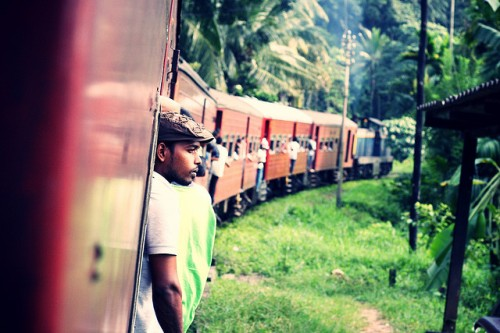 Train riders in the Sri Lankan highlands.