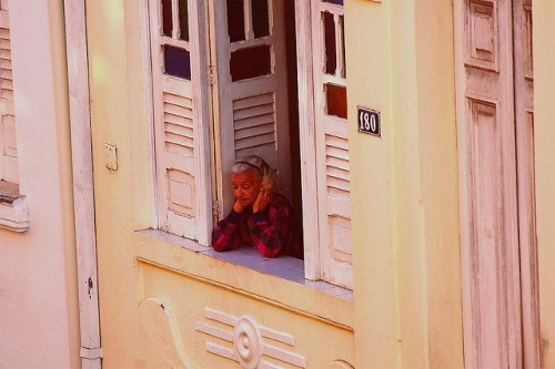 An old woman looks out her window in Salvador. By Terenzio Lodadio